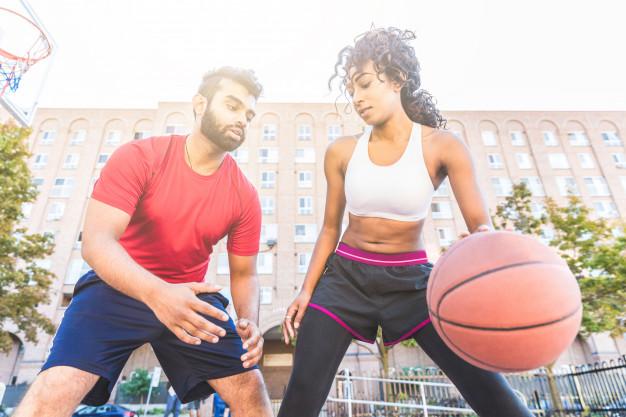 woman-vs-man-playing-basketball-toronto_108072-2016